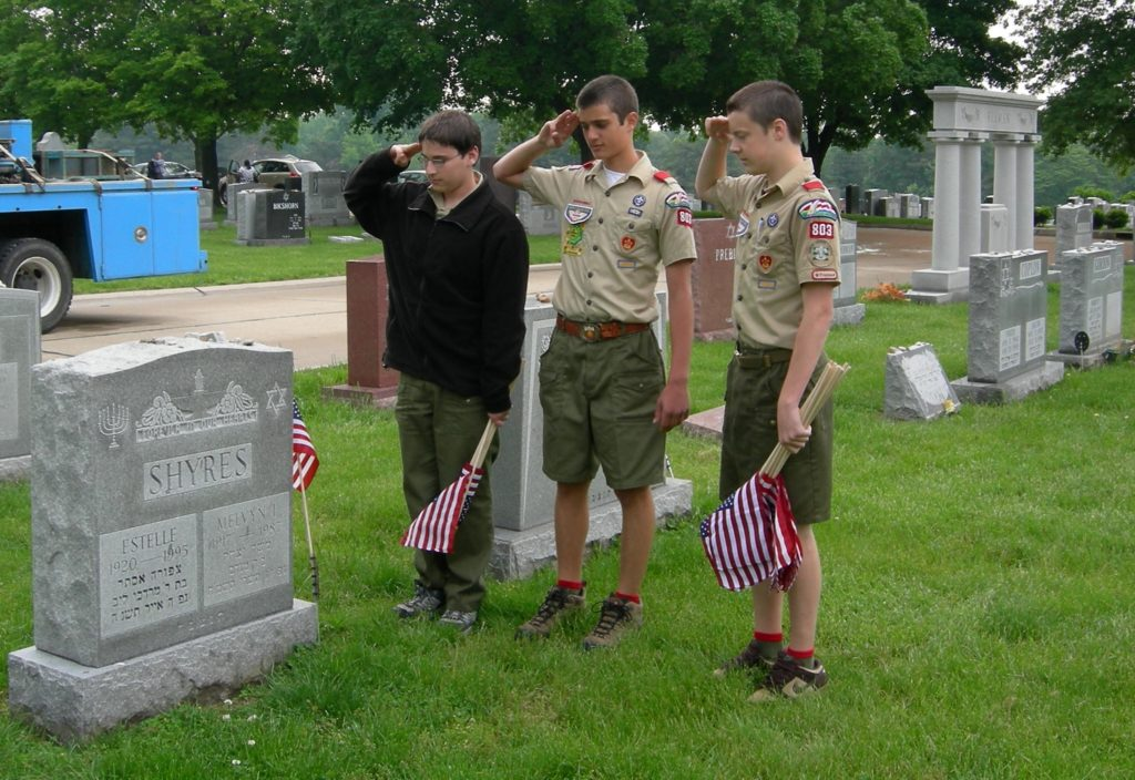 Boy Scouts placing flags at Veteran grave sites